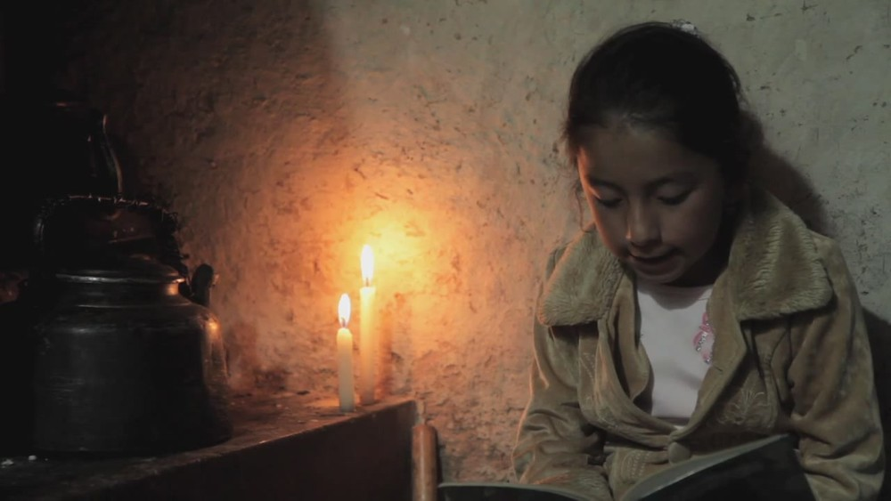 Samay reading by candlelight.jpg