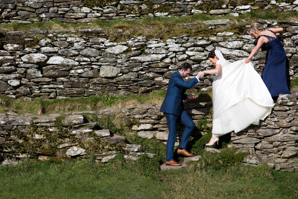 Claire and Aidan - Co. Donegal, Ireland A beautiful sunny day, clear skies, shades, a Cathedral, and old fort, double decker bus and singing galore! Read the whole story here