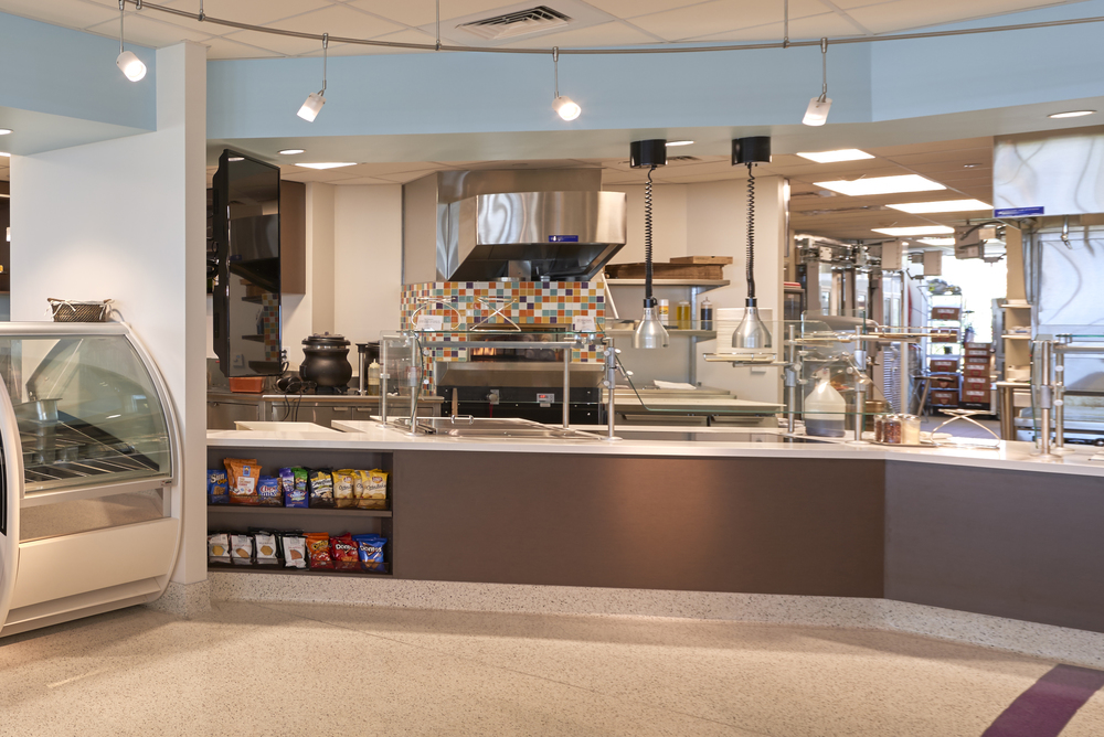 Cooking equipment is an integral part of Mountainside Café, allowing customers to see some of the production while selecting their menu fare. The terrazzo floor's gentle curved shapes support wayfind and add visual interest.