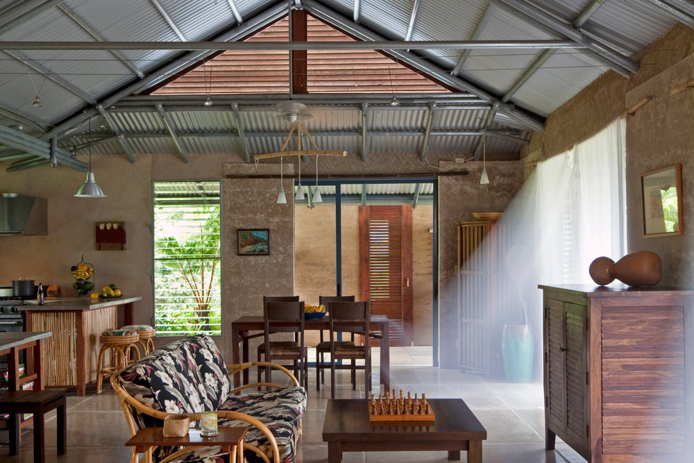 The key to comfort in the tropics is ventilation - lots of it. We used supporting earth walls as sparingly as possible. Big panels of sliding glass open to mimic the original concept of a Hawaiian hale. Open gable ends and cupolas keep the air flowing through the pavilions. Breezeways accelerate air movement.  The property is currently for sale.    Image © Art Gray