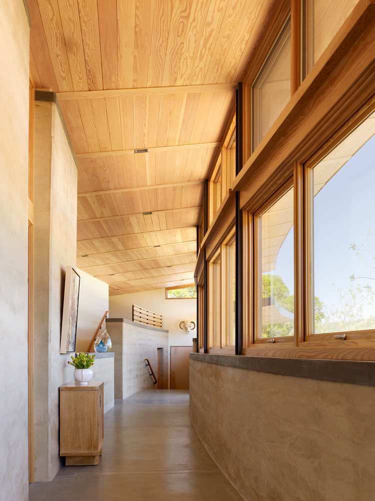 Caterpillar House in Carmel Valley by Rammed Earth Works