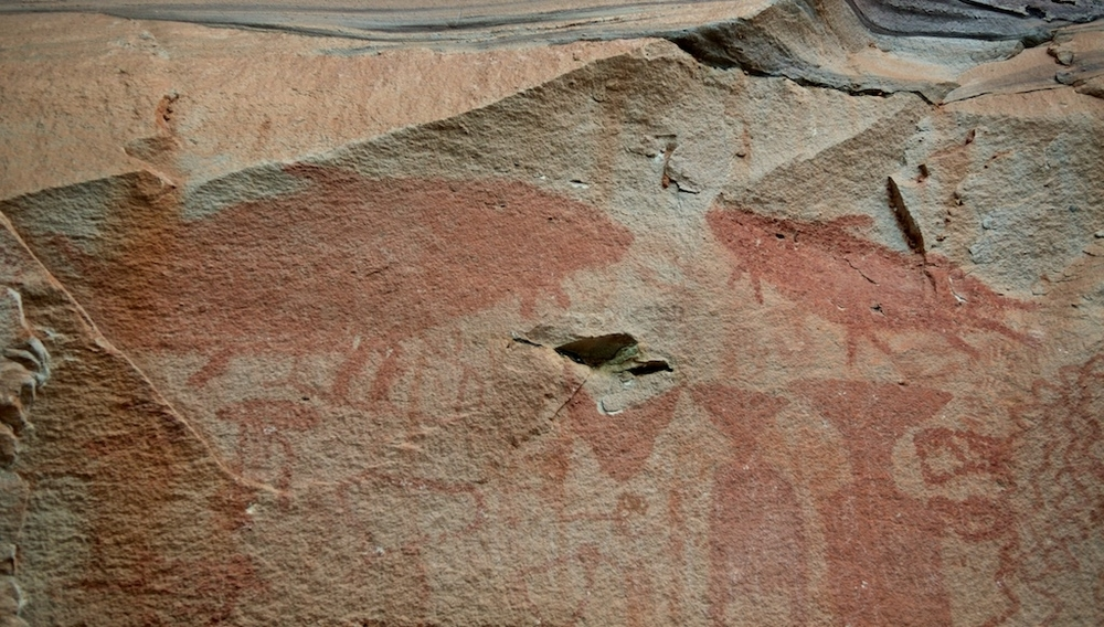 3,000 year old cliff paintings of giant catfish illustrate the historical importance of the Mekong to riparian cultures. | Pha Taem, Ubon Ratchathani, Thailand