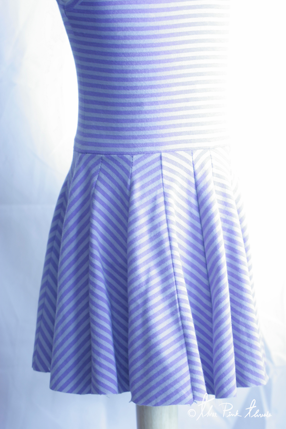 Above is an un-hemmed natural circle skirt, which falls quite nicely on it's own but having split the circle skirt up into sections to create the chevron design my circle skirt was not quite as perfect as I wanted it to be for this dress I'd been imagining for a very long time.