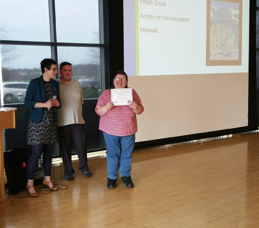 "Debbie receiving her certificate for her ""Fresh Snow"" painting."
