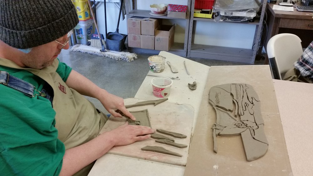"Here is James cutting and carving the pieces which became his ""Shoreline"" mosaic."