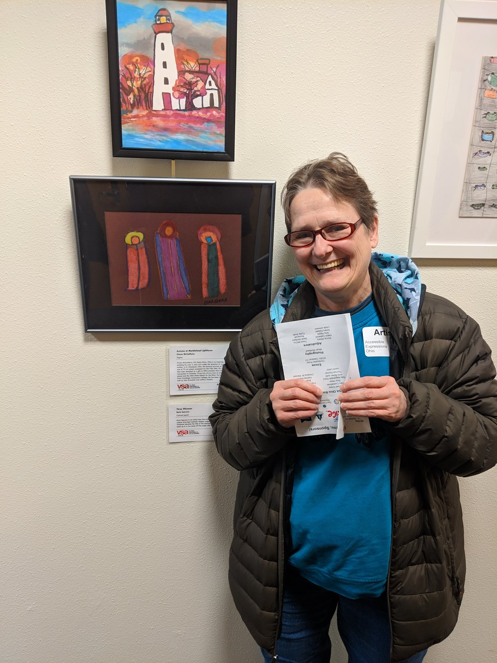 """AOS artist Barb Seevers next to her colored pencil drawing """"Three Wisemen"""""""