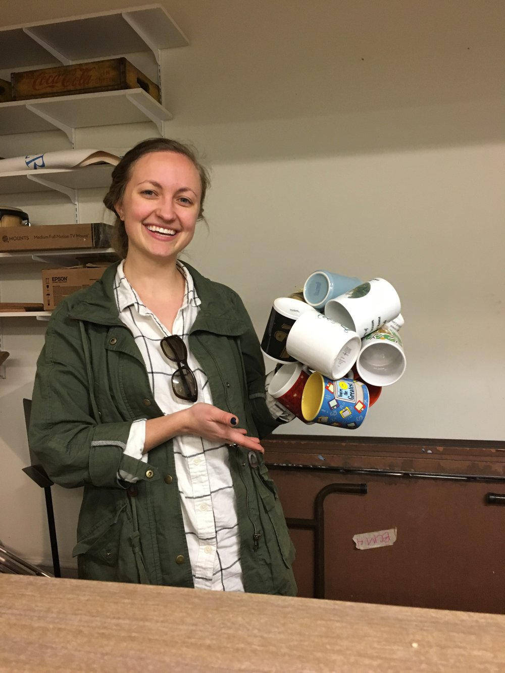 Katharine Batchelor, Director of Christian Life. There's an on-going contest for how many coffee mugs you can hold in one hand. Katharine set the bar high with 11.