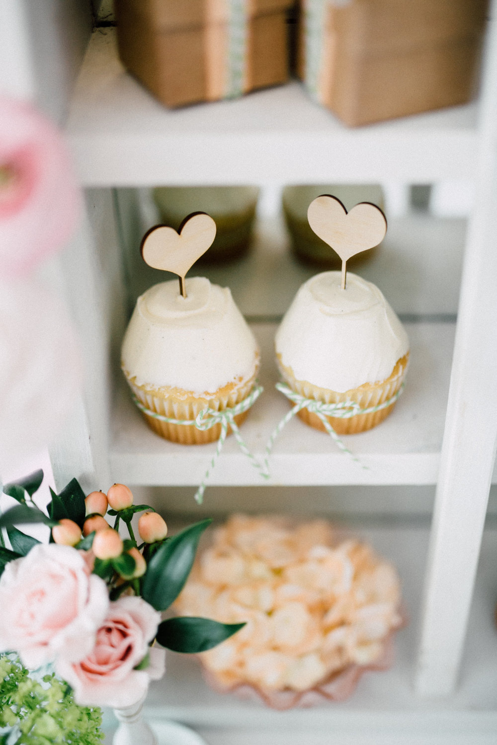 Heart topper cupcakes - Bun In The Oven Baby Shower (Style Me Pretty & SMP Living)