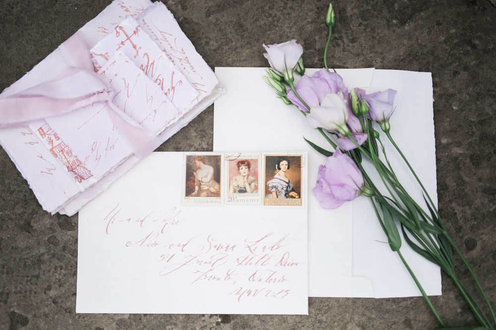 Lavender watercolour invitations with rose gold calligraphy and vintage stamps - Fairytale Wedding (Wedluxe)