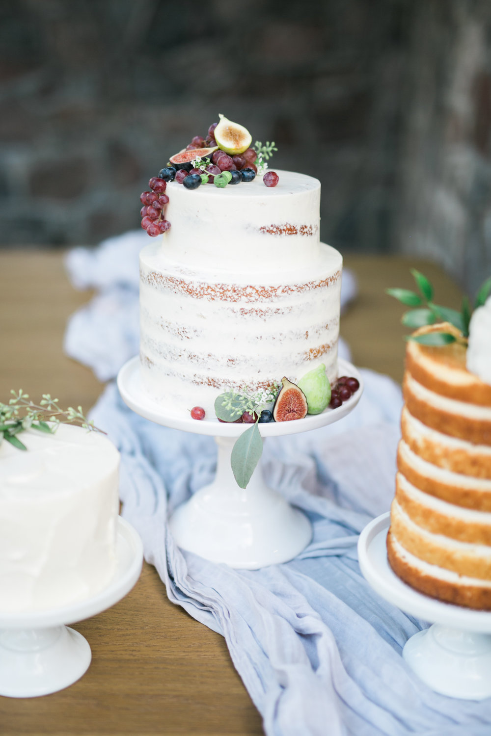 Half naked cakes with florals and fruits - Fairytale Wedding (Wedluxe)