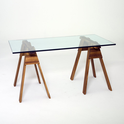 Zebra wood, glass top sawhorse table (gavinzeigler.com)
