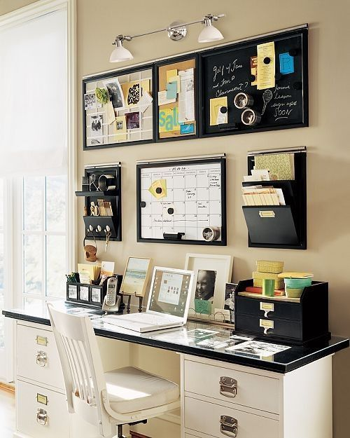 This complete workstation has two drawer units below, smaller storage drawers sitting on top and wall mounted storage.
