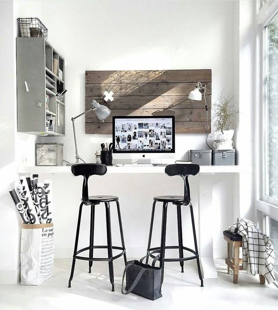 These drawing chairs can be used as bar stools so I'm throwing them into the mix. In this case the desk is higher, at bar height.