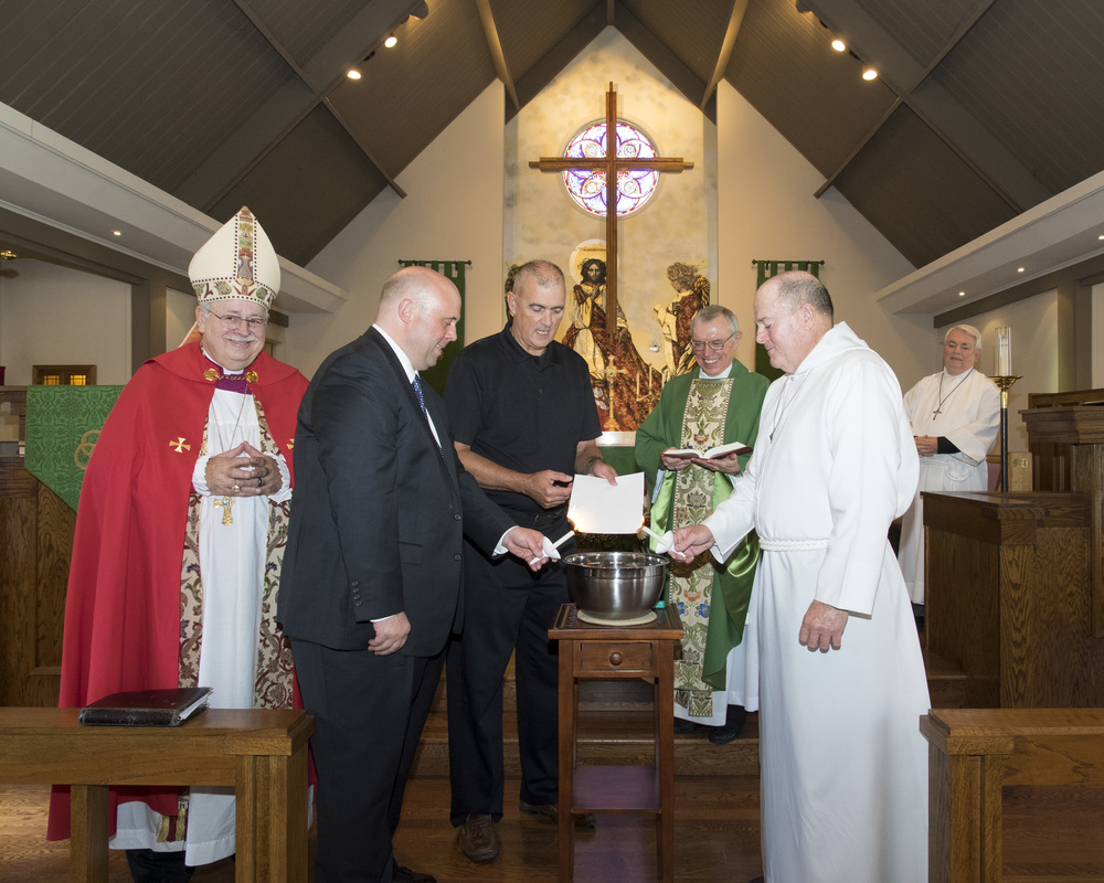 The mortgage burning ceremony with Bishop Grote, Bill Petry, John Gregory, Father Ron Martin, and Woody Freeman     This ceremony was made possible by a generous donation by Bill Petry.  Bill was here to honor his mother, Margaret Petry, and to celebrate with the church on the Sunday nearest her birthday.