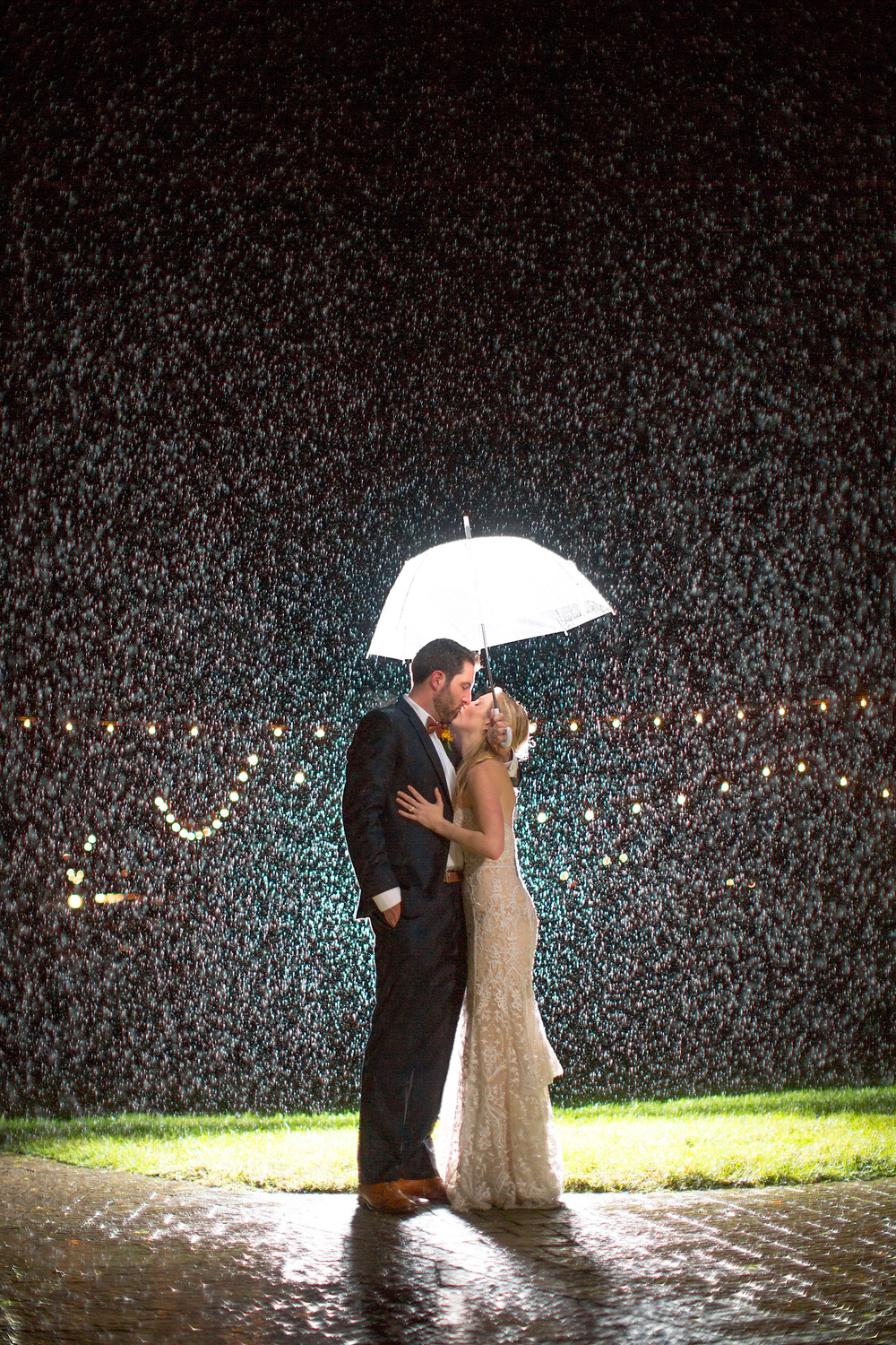 "I love this photo. And it's gone a bit ""viral"" sure. But what excites me about this photo is the couple. I remember talking to them during our consultation about chipotle and the redskins. I look at this image and think about how willing they were to let me try something different and how awesome they were about the torrential downpour on their wedding day."
