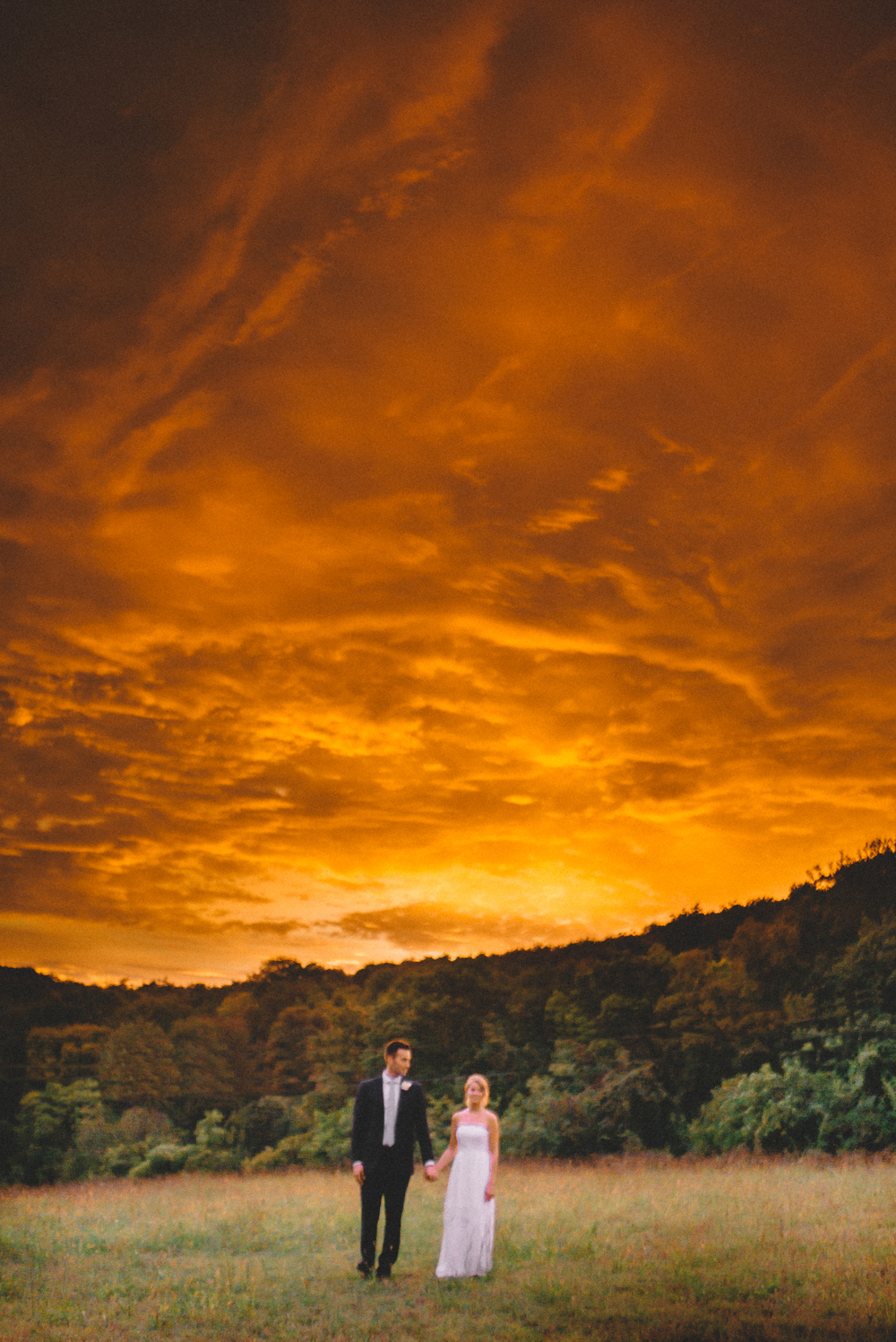 Again the earth looks like it's on fire... (no this wasn't photoshopped... its the sun setting below the clouds. it was crazy) and it looks like its a love story being told on the last day before the apocalypse. But Ben and Laura are two of the best people I know. And I am reminded of that every time I see their images.