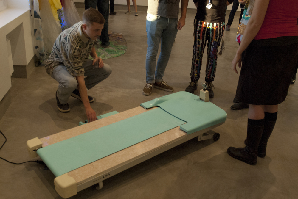 Matt Goldberg showcases his sculpture  Cadillac Treadmill  in movement   to fellow artists.