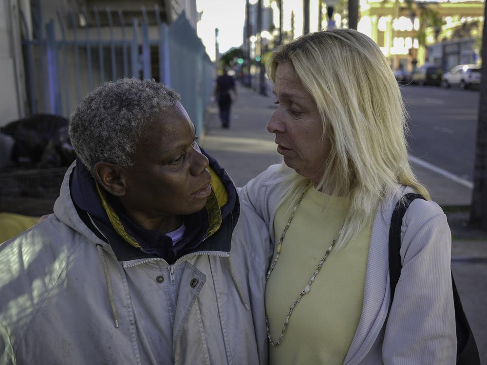 Sylvia hugs blond woman copy.jpg