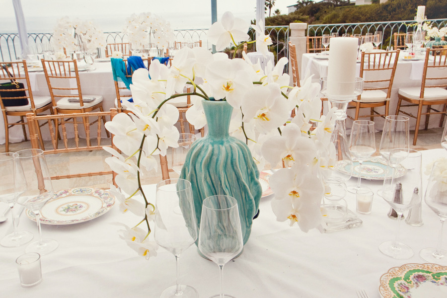 white-orchid-wedding-centerpiece-with-turquoise-vase.original.jpg