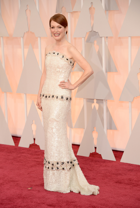 Julianne Moore in Chanel:  This dress is oh-so classic Chanel. The custom design with flowerette features was simply to die for and perfect for a very classic yet chic bride. We picture Audrey Hepburn when we look at this gown. Love the low bridal bun and drop jewellery.