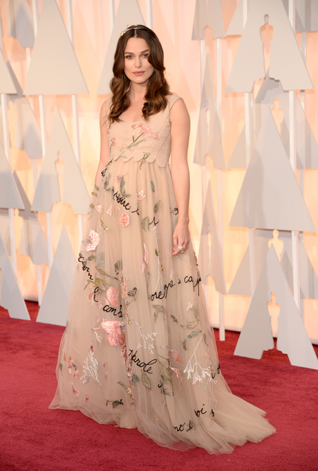 Kiera Knightley in Valentino:  Whimsical, soft and romantic. This garden wedding appropriate gown was a show stopper. The French script along the skirt makes this gown spectacularly unique and fashionable. The hair and make-up also helps finish off the look - soft curls and mauve lipstick.