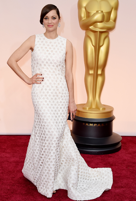Marion Cotillard in Christian Dior Haute Couture.  Gorgeous white dress with circular sheer cutouts and long train that flared from a black strap at the back.