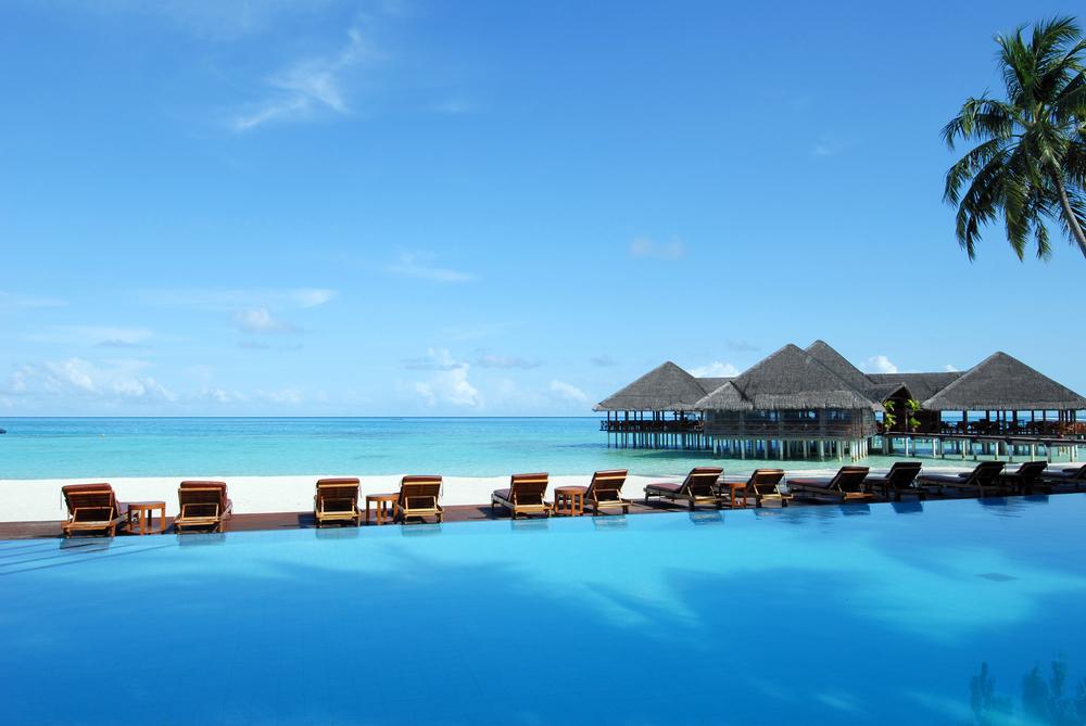 Maldives-beach-bungalow-shutterstock_103246064.jpg