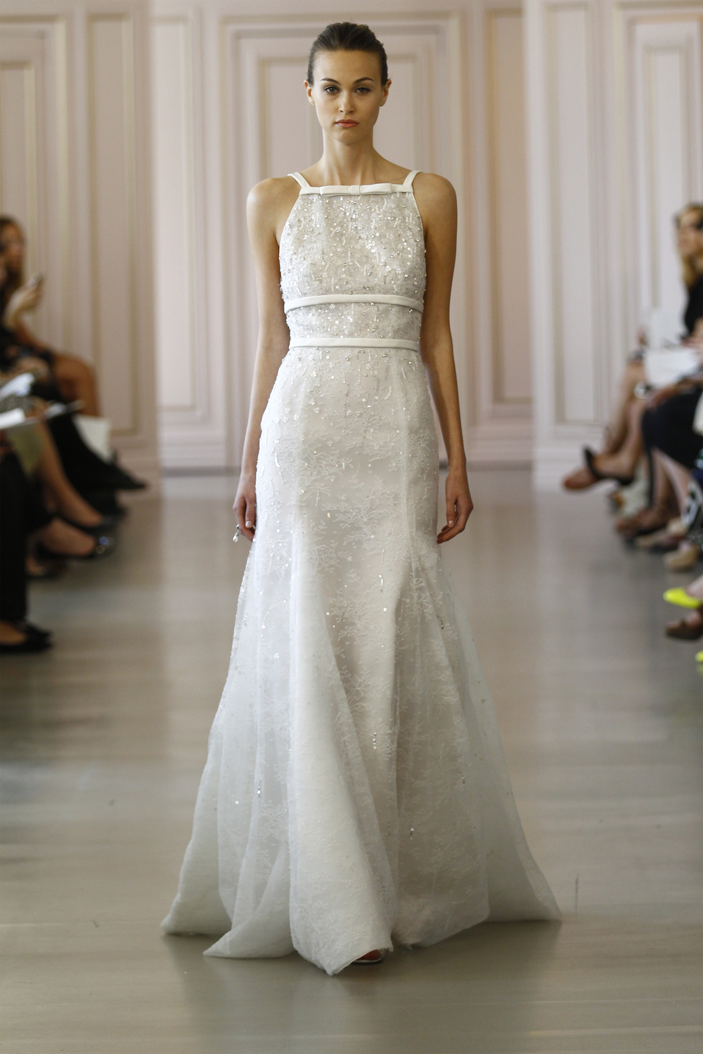 Sarah Ivory Chantilly lace gown with crystal and sequin embroidery and radzimir belt. Silver and crystal ring, white ribbon embroidered sandal.