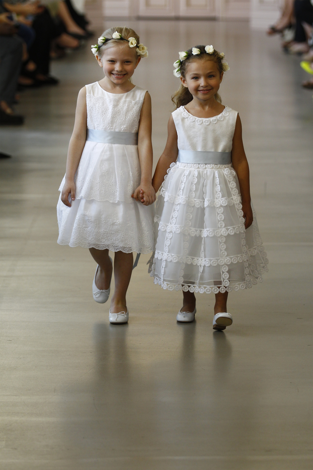 Matilda - White cotton eyelet flower girl dress with pale blue satin ribbon. White leather ballerina shoes.  Milena - Ivory silk organza flower girl dress with dotted guipure and lace trim. White leather ballerina shoes.
