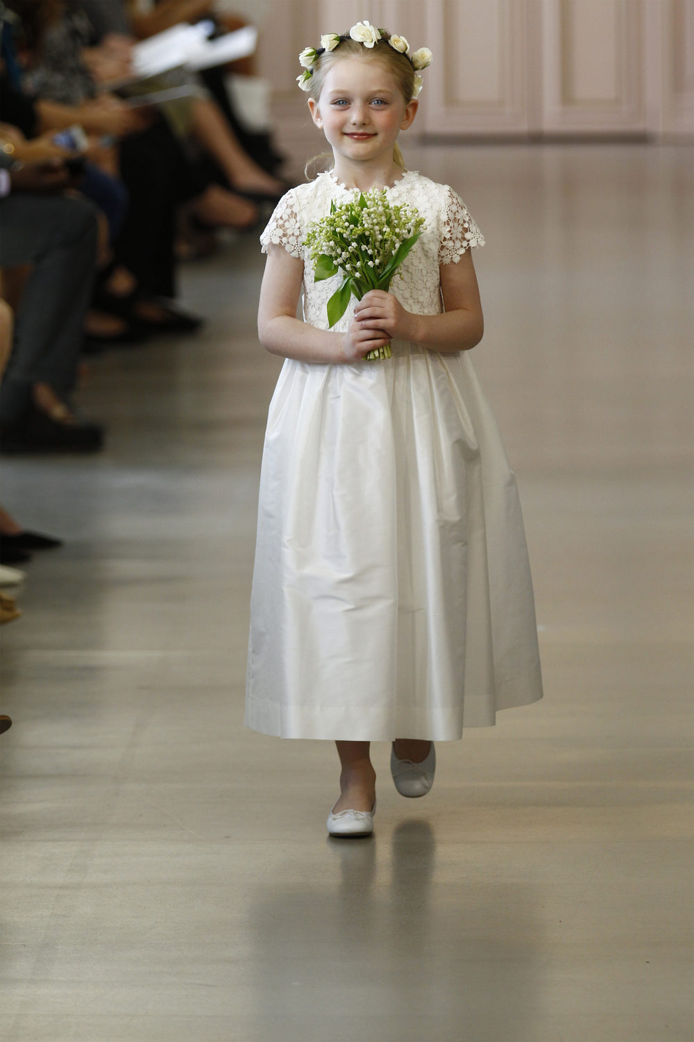 Alastriona - White silk snowflake lace flower girl dress with silk taffeta skirt. White leather ballerina shoes.   (Photos provided by Oscar de la Renta)
