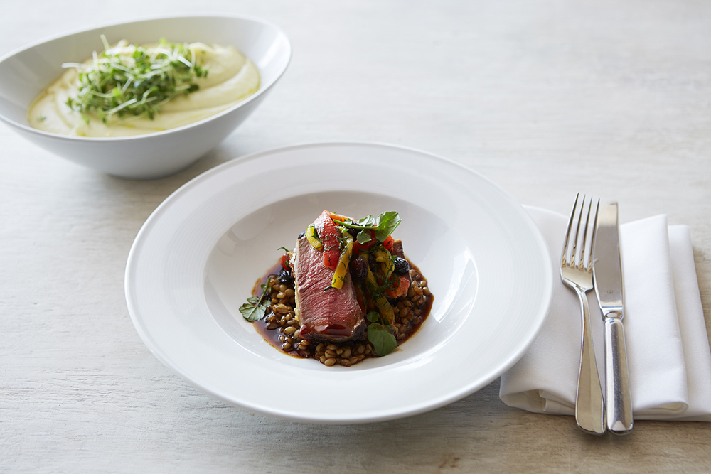 Roast rack of lamb with pearl barley, peperonata with tea soaked raisins.jpg