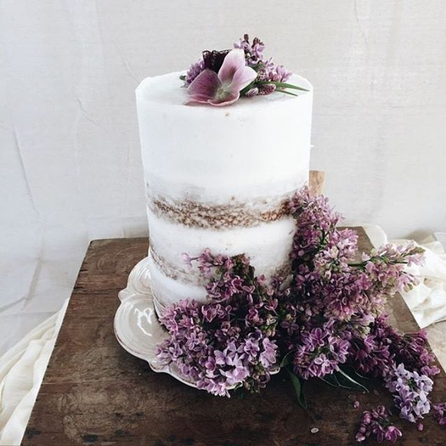 """How romantic is this """"undone"""" wedding cake style? Complete with floral adornments. #WeddingCake #Romantic #Botanical #WeddingInspiration #WeddingPlanning #TheBridalCoach #KissesandCake #KissesandCakeWeddings   Image: thelane.com"""