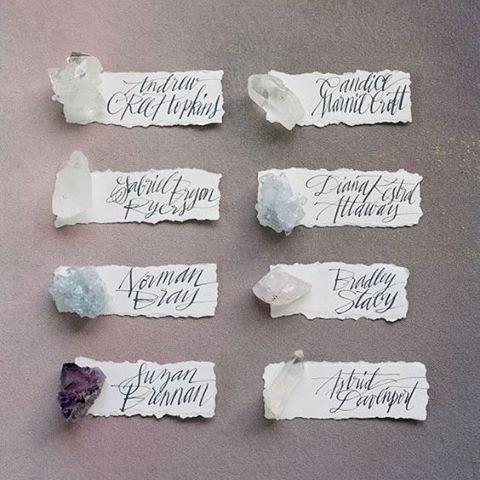 Adding earthy elements, like semi precious stones, to your place cards provides an eclectic mood for your guests. #Crystals #Geodes #SemiPreciousStones #Quartz #EscortCard #WeddingInspiration #WeddingPlanning #TheBridalCoach #KissesAndCake #KissesAndCakeWeddings | Image:Corbin Gurkin Photography via greenweddingshoes.com
