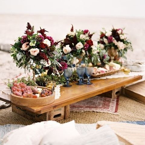 There's never such a thing as too many floral arrangements! #Flowers #Beach #BoHo #WeddingInspiration #WeddingPlanning #TheBridalCoach #kissesandcake #KissesAndCakeWeddings| Image: When He Found Her Photography via greenweddingshoes.com