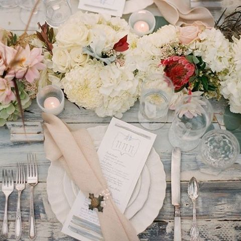How dreamy is this table setting? Complete with plenty of florals, dainty candles and a rustic wood table. #Flowers #TableSetting #Rustic #Candles #WeddingInspiration #Weddings #WeddingPlanning #TheBridalCoach #KissesAndCake #KissesAndCakeWeddings   Image: Jose Villa Photography