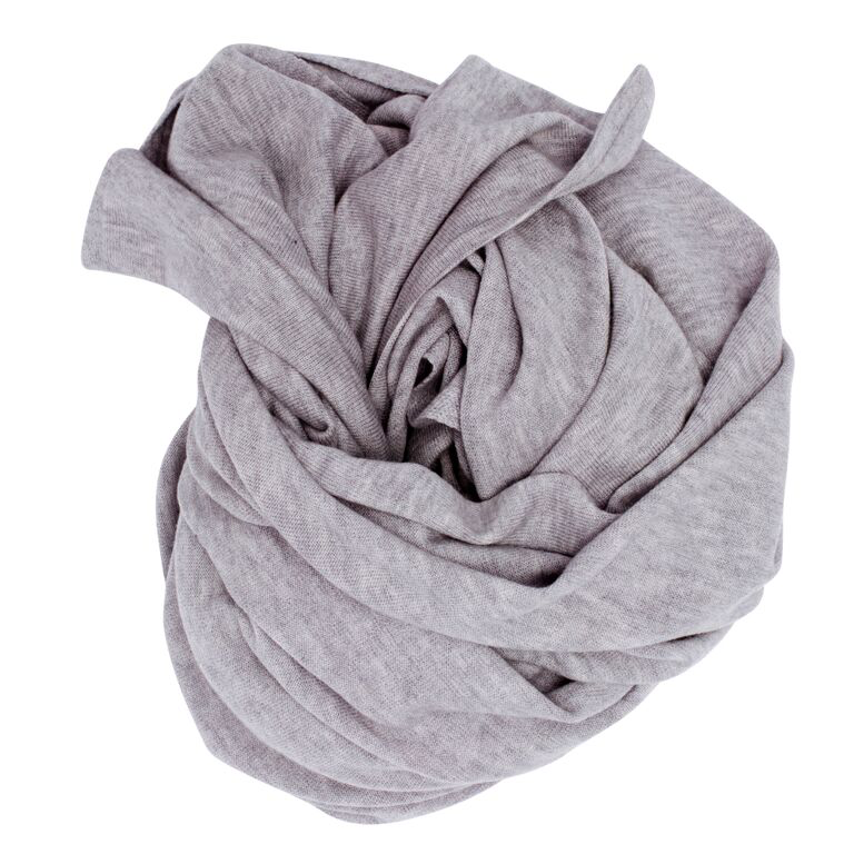 100% Merino Oversized Wrap In Light Grey Super soft washed merino, this item is often mistaken for cashmere. Easily our most versatile piece. Can be worn as a full sized cape, wrapped around and styled, or as an oversized scarf. The ultimate travel companion. Great for flights and layering up for cooler mornings and evenings. An elegant staple.