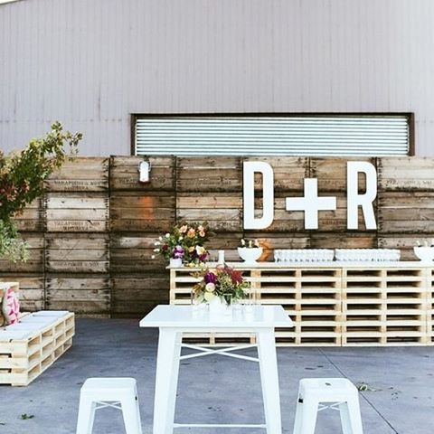 Create a fun casual bar space for your guests to enjoy some after ceremony cocktails. This area doesn't need to cost a fortune. You can use old crates, op shop pillows and dress it up by reusing some of your ceremony flowers. #TheBridalCoach #weddinginspiration #KissesAndCakeWeddings #kissesandcake #bar #cocktail #alcohol #wedding #decor #weddingplanner #styling #sydneybride #sydneywedding #bridalblogger #weddingblogger #inspiration   Image/styling: the style co