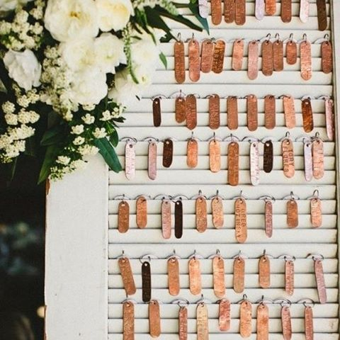 A unique way to welcome your guests to their table is by giving each guest a copper key tag with their name on it. It would also make a nice keepsake for your guests.   Image: The Bridal Detective   #copper #tablechart #seating #wedding #weddingplanner #weddinginspiration #reception #thebridalcoach #kissesandcakeweddings #kissesandcake #sydneybride #sydneywedding #bridalblogger #weddingblogger #inspiration  More inspiration on our website, kissesandcake.com.au