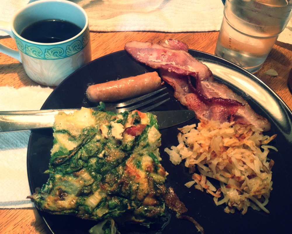 An example of the Ferreira family's holiday breakfast. A giant egg casserole, breakfast meats galore, hash browns, and coffee.