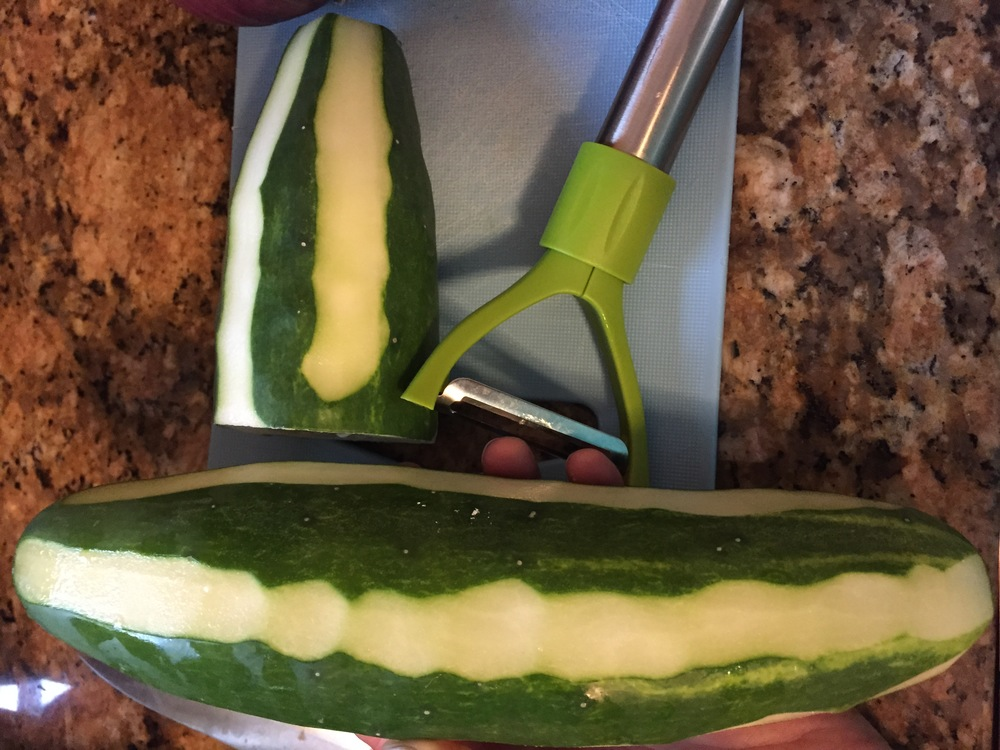 Honestly, this is not necessary, it just makes the cucumber look pretty when it's cut and it gets rid of what can sometimes be a tough skin