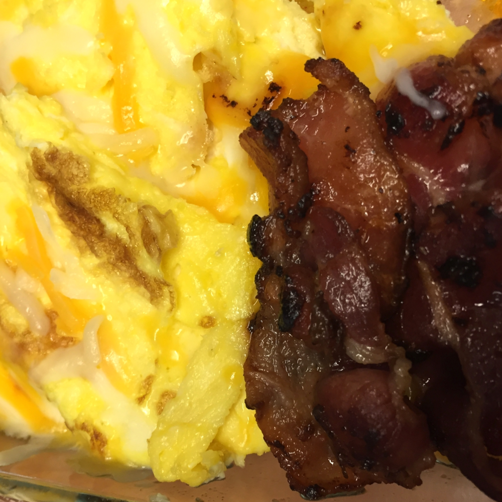Scrambled eggs, bacon, plantains = breakfast of champions
