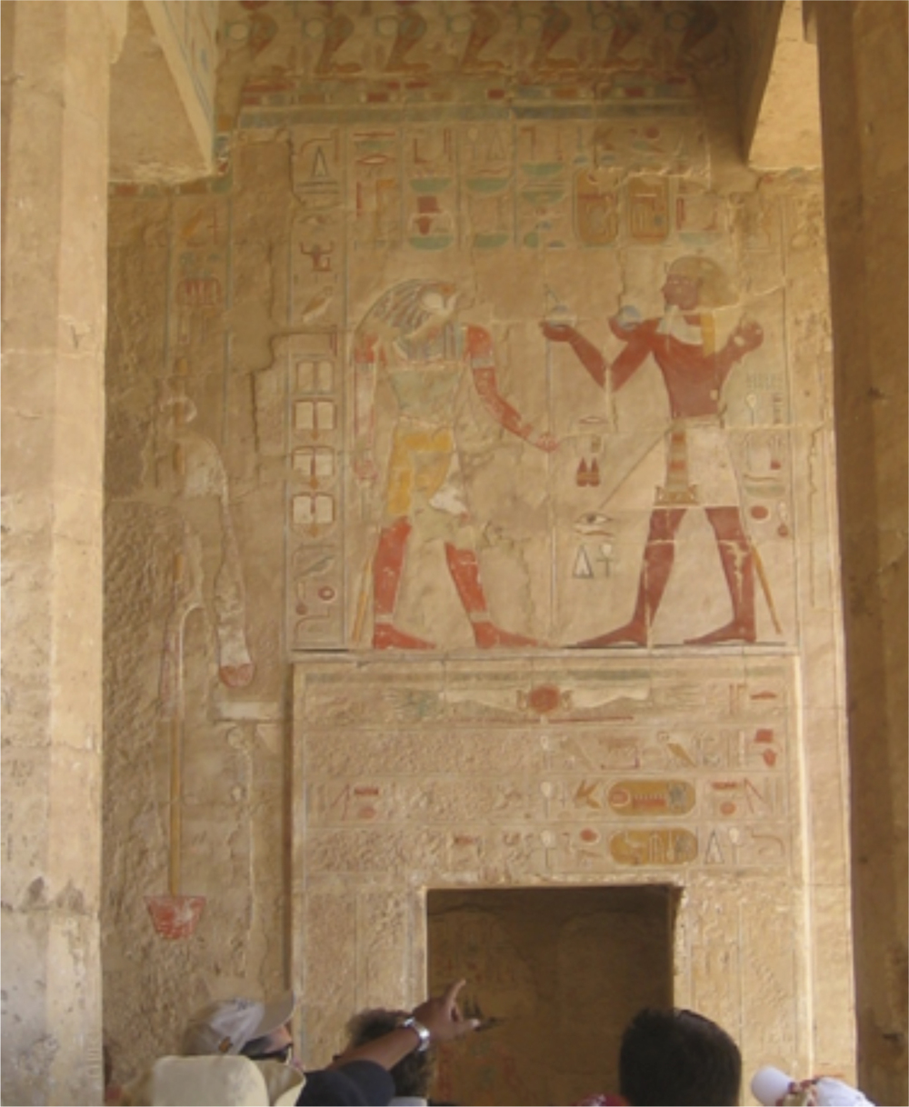 Detailed, colorful sculpture on the wall of Queen Hatshepsut's Temple