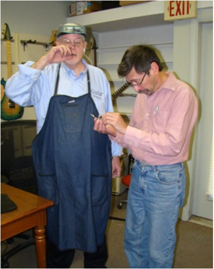 PATRICK CUMMINGS WITH JOE CAPLAN IN HIS WORKSHOP
