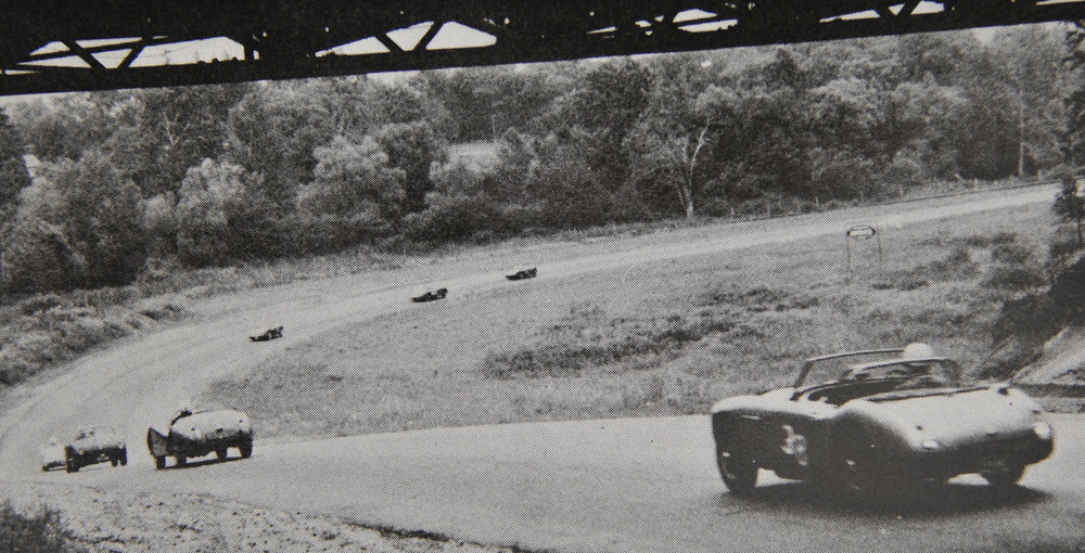Sports cars racing under the Bailey Bridge, still in use today