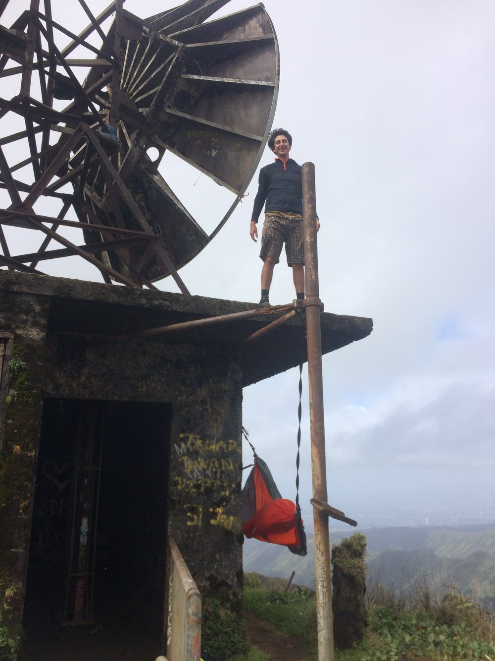 My brother climbing atop the satellite of the old military communications tower...because climbing 3,992 steps was not enough for him!