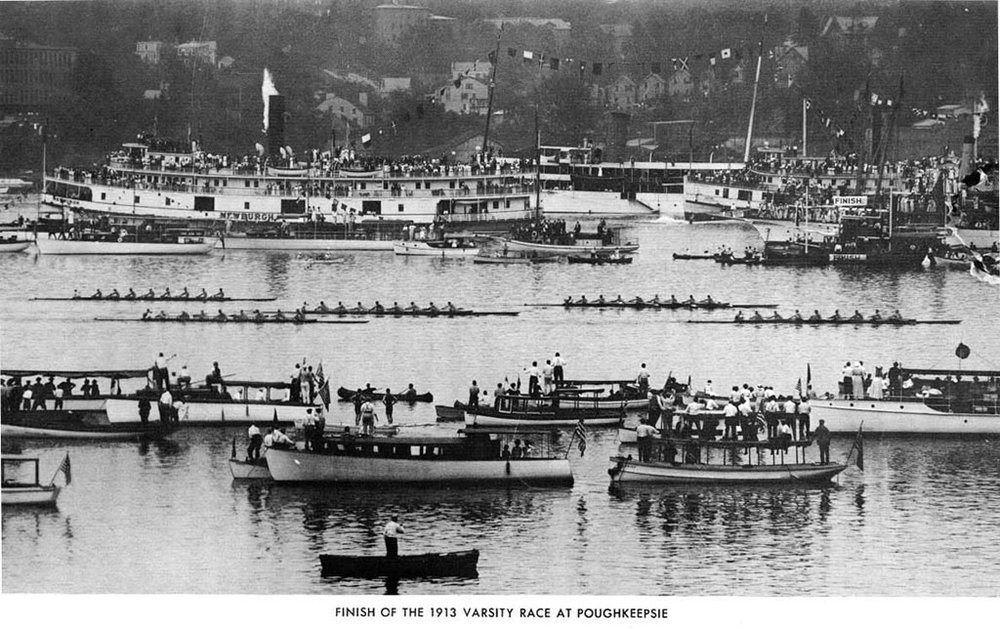 Syracuse defeats five other crews the varsity race in the Poughkeepsie Regatta of 1913 surrounded by fans and officials on boats of all kinds.