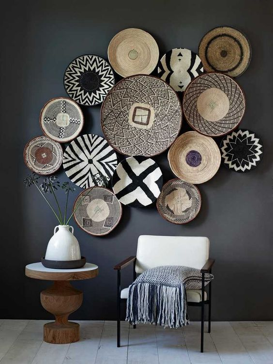 a collection of baskets make up this striking gallery wall  via  deco a tous les etages