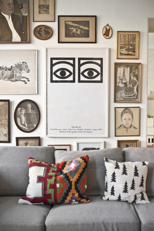 with a variety of different framed pieces this gallery wall feels cohesive not only because each piece has space to breathe (a must with all gallery walls) but because it fills the entire wall  (via luv decor)