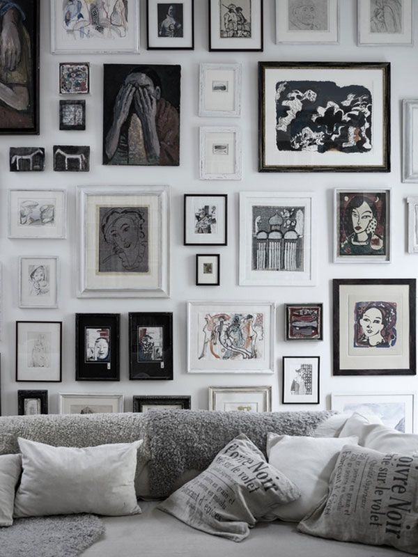 this black and white gallery wall via d etails oriented  is already uniform in palette but is truly exceptional because it's  floor to ceiling span evokes a feeling of the louvre galleries of yore