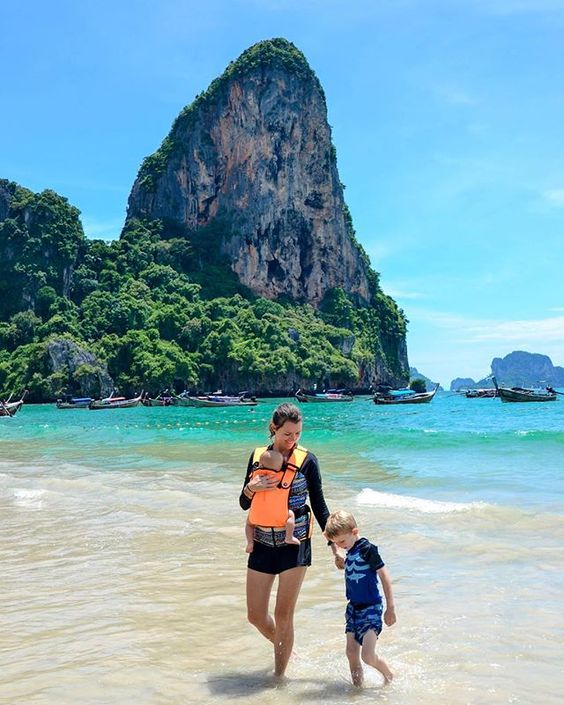 Thailand - Jessica enjoys a magicalbeach with her toddler usingtheir Frog Orange to settle her babe.